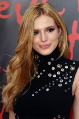 Bella Thorne with long wavy honey blonde hair, June 2015. Celebrity hairstyles   star style beauty and make up