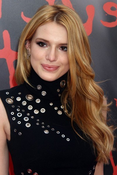Bella Thorne with long wavy honey blonde hair, June 2015. Celebrity hairstyles | star style beauty and make up - flipped