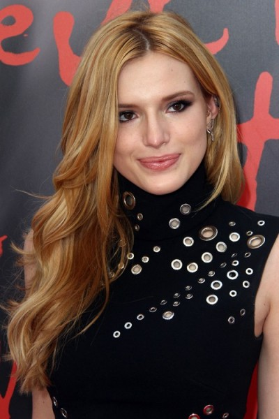 Bella Thorne with long wavy honey blonde hair, June 2015. Celebrity hairstyles | star style beauty and make up
