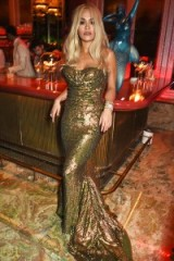 Rita Ora wowed in this gold strapless fishtail gown, at the launch party of Sexy Fish Restaurant in Berkeley Square, London, 8 October 2015. Celebrity style | glamorous gowns | events