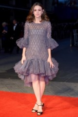 Carey Mulligan was red carpet perfect when she wore a glittering grey Chanel Couture gown, with statement ruffle edging & a pair of black Salvatore Ferragamo heels to the Suffragette premiere, during the BFI London Film Festival, October 2015. Celebrity style | designer gowns | ruffled dresses | film premieres