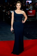 Looking elegant on the red carpet, Kate Winslet attended the last evening of the BFI London Film Festival dressed in a navy one shoulder Alexander McQueen gown. Celebrity style – film premieres – designer gowns