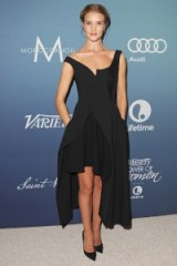 Rosie Huntington-Whiteley attends the Power of Women luncheon in Beverly Hills wearing a black asymmetric dress & pointy pumps, October 2015. Celebrity style – events – chic looks