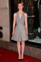 "Actress Mia Wasikowska wearing a grey sleeveless dress with a box pleat skirt by Alexander McQueen, attends the Bergdorf Goodman ""Crimson Peak"" inspired window unveiling at Bergdorf Goodman in New York City, 13 October 2015. Celebrity style – outfits – designer skirts"