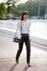 Glamour at Paris Fashion Week ~ glamorous street style ~ lace blouse leather trousers