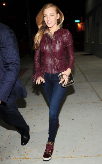 Blake Lively leaves a magazine shoot in New York, 14 October 2015. Celebrity street style | celebrities wearing skinny jeans & burgundy leather jackets - flipped