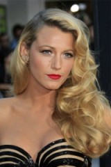 Blake Lively's long wavy golden blonde hair. Hollywood glamour – celebrity hairstyles – makeup – beauty