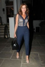 Carol Vorderman steeping out in style wearing an open neck top and blue fitted trousers