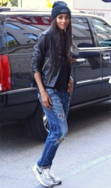 Ciara New York street style…black leather biker jacket, ripped jeans, pale blue trainers and a beanie. Celebrities wearing denim | celebrity fashion | casual outfits