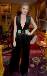 Lily Donaldson wearing a Balmain black pleated velvet jumpsuit (sold at harveynichols.com) & a high waist pleated satin belt in green ( sold at luisaviaroma.com )