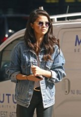 Selena Gomez street style out in NYC, October 2015…faded blue denim jacket, white tee & leather pants. Casual celebrity fashion | star style clothing | jackets | celebrities wearing denim