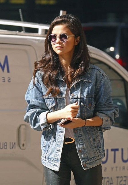 Selena Gomez street style out in NYC, October 2015…faded blue denim jacket, white tee & leather pants. Casual celebrity fashion | star style clothing | jackets | celebrities wearing denim - flipped