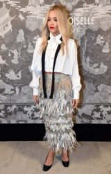 Rita Ora wearing a cropped white shirt & silver/grey feathered skirt at the Chanel Mademoiselle Prive Exhibition launch party, Saatchi Gallery, London, October 2015. Celebrity fashion – star style – designer outfits – feathers – skirts
