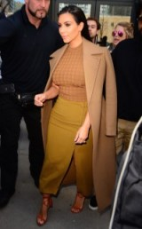 Kim Kardashian chic style in camel and olive green. Celebrity fashion | star style | Kim's outfits | Kardashian's fashion
