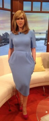 Kate Garraway putting her best foot forward in this pale blue ASOS dress and red wedge heels!