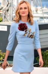 Diane Kruger attends the Disorder photocall during Cannes Film Festival, wearing a Dolce & Gabbana pale blue sequinned rose mini dress farfetch.com, 16 May 2015. Celebrity fashion | star style | designer mini dresses | embellished | celebrities at film festivals