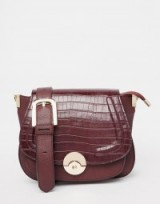 Luxe style accessories…Dune Delphine Croc Effect Winged Saddle Bag in Berry. Luxury looks ~ faux leather handbags ~ shoulder bags