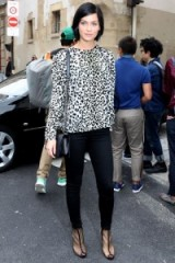 Leigh Lezark's street style wearing a black & white leopard print top & black fitted trousers. Celebrity fashion – animal prints – outits