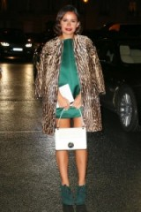Miroslava Duma looks glamorous in this animal print coat, draped over a silky emerald green mini dress and worn with dark forest green booties. Celebrity fashion – outfits – style icons