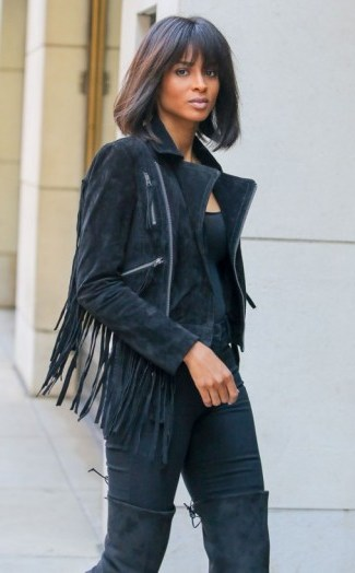 Ciara looks sensational in this all black outfit…plain tee, fringed suede jacket, skinny pants and over the knee boots. Celebrity street style   inspirational outfits - flipped