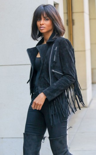Ciara looks sensational in this all black outfit…plain tee, fringed suede jacket, skinny pants and over the knee boots. Celebrity street style   inspirational outfits