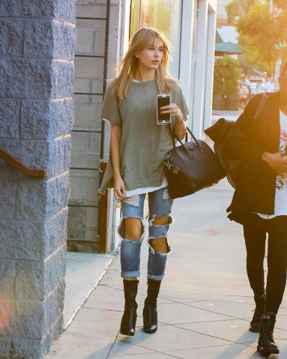 Hailey Baldwin street style in totally ripped jeans. Models off duty | celebrity fashion | celebrities in distressed denim - flipped