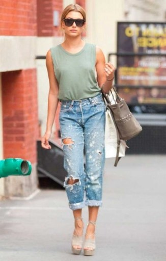 Hailey Baldwin street style… light green tank, distressed jeans and strappy platforms. Models off duty | casual celebrity fashion | celebrities wearing ripped denim - flipped