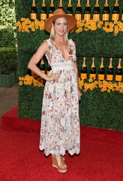 70s boho style…Brittany Snow in a floral maxi dress, tan high heel wedges and a wide brim hat, attends the Sixth-Annual Veuve Clicquot Polo Classic at Will Rogers State Historic Park on 17 October 2015, Pacific Palisades, California. Celebrity fashion | star style | celebrities at events | outfits - flipped