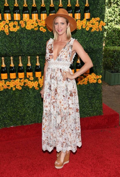 70s boho style…Brittany Snow in a floral maxi dress, tan high heel wedges and a wide brim hat, attends the Sixth-Annual Veuve Clicquot Polo Classic at Will Rogers State Historic Park on 17 October 2015, Pacific Palisades, California. Celebrity fashion | star style | celebrities at events | outfits