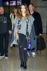 Jessica Alba travel style…wearing a pair of black destroyed cropped jeans, grey blanket coat & ankle boots. Celebrities wearing denim | celebrity fashion | star style | outfit inspiration