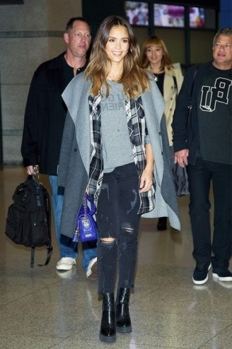 Jessica Alba travel style…wearing a pair of black destroyed cropped jeans, grey blanket coat & ankle boots. Celebrities wearing denim   celebrity fashion   star style   outfit inspiration - flipped