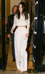Kendall Jenner in a Bibhu Mohapatra blush feathered silk top and matching wide leg trousers, Paris, October 2015. Celebrity fashion | star style | luxe style outfits