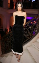 Kendall Jenner's Paris Fashion Week glamour – Kendall Jenner wearing a black velvet Ulyana Sergeenko strapless couture dress with a white ruffle hemline and a pair of barely there sandals, at Vogue's 95th Anniversary Party. Celebrity fashion | star style | PFW events | designer gowns