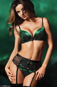 Miranda Kerr in a Victoria's Secret black emerald with green lace and garter belt lingerie