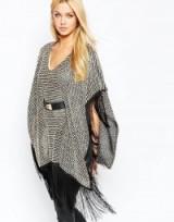 Lipsy Fringe Trim Belted Poncho. Winter outerwear – chic ponchos – fringed fashion