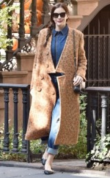 Liv Tyler steps out of her West Village home, wearing double denim and a statement leopard print coat, October 2015. Celebrity street style | fashion & outfits