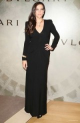 Liv Tyler wore a black long sleeved column gown & accessorized with eye-catching Bulgari jewels, when she attended the BVLGARI & ROME Eternal Inspiration Opening Night, held in New York City, 13 October 2015. Celebrity style – celebrities at events