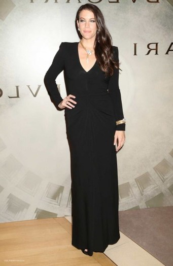 Liv Tyler wore a black long sleeved column gown & accessorized with eye-catching Bulgari jewels, when she attended the BVLGARI & ROME Eternal Inspiration Opening Night, held in New York City, 13 October 2015. Celebrity style – celebrities at events - flipped