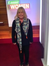 Linda Robson wearing a shirt from Marks and Spencer and a Jigsaw scarf #looswomen