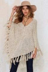 Nasty Gal Knitflix and Chill Poncho beige. Womens ponchos | knitted outerwear | asymmetric fringe hem | knitwear