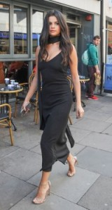 Selena Gomez does sexy chic in this black slinky slip dress & scarf with a pair of barely there sandals. Celebrity fashion | star style | LBD | street style