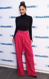 Nicole Scherzinger looking fab in pink wide leg trousers and a black polo neck sweater, New York, October 2015. Celebrity fashion | outfits
