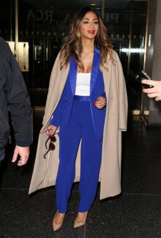 Nicole Scherzinger wearing a blue Diane von Furstenberg crepe trouser suit, available from selfridges.com, leaving the Today Show in New York City, 20 October 2015. Celebrity fashion | star style | designer trouser suits | what celebrities wear