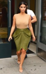 Kim Kardashian style dressed in a nude sleeveless jersey top, olive draped skirt and nude barely there sandals. Celebrity fashion | Kim's outfits | star style | Kardashian's fashion