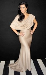 Kim Kardashian's vintage Hollywood style wearing a draped blush gown and eye-catching jewels. Celebrity glamour | Kim's gowns | Kardashian fashion | star hairstyles