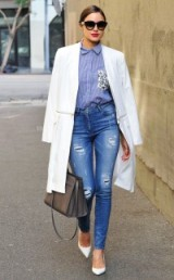 Olivia Culpo street style chic out in West Hollywood, October 2015. Celebrity fashion | celebrities wearing denim | destroyed skinny jeans