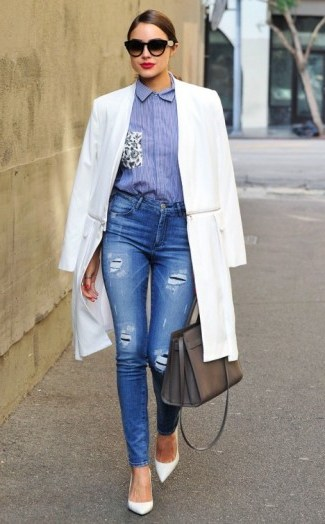 Olivia Culpo street style chic out in West Hollywood, October 2015. Celebrity fashion | celebrities wearing denim | destroyed skinny jeans - flipped