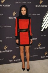 Leigh Lezark wears a red and black high neck mini dress to the Remy Martin and Jeremy Renner Present One Life/Live Them event in New York, October 2015. Celebrity fashion | star style | events