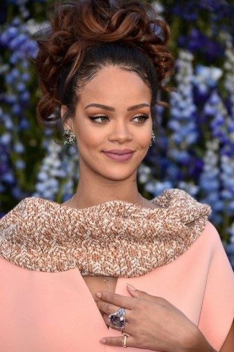 Rihanna at Dior S/S 2016 PFW. Celebrity style | glamour | Front Row celebrities | hairstyles & make up | updos | jewellery