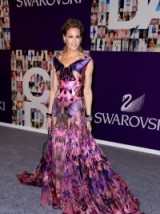 Sarah Jessica parker looks beautiful in this stunning purple gown with a floral & butterfly print. flower printed gowns / celebrity fashion / alexander mcqueen prints